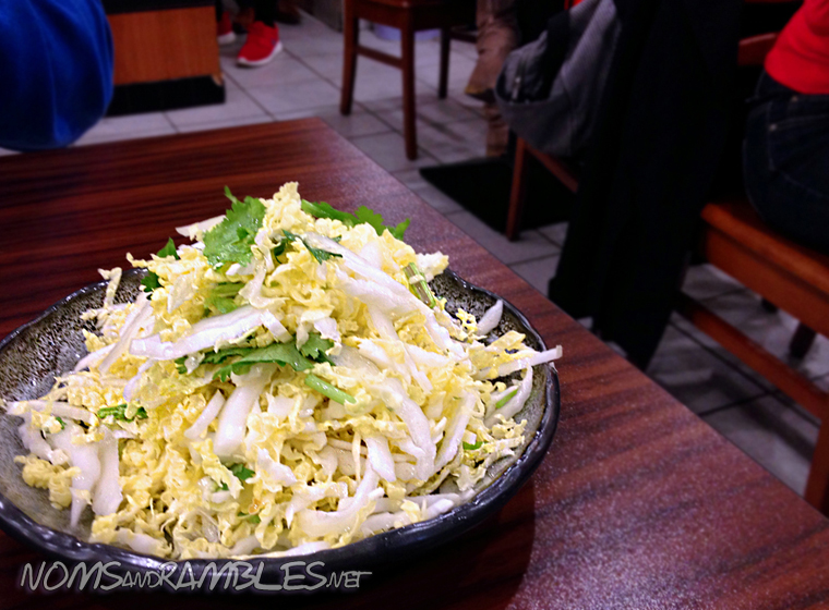 Sweet and sour shredded cabbage salad with a dash of sesame oil