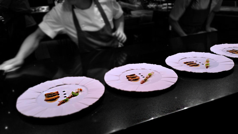 Plating up the roast marron in the kitchen