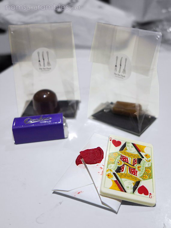 Queen of Hearts white chocolate playing card; aerated chocolate and mandarin jelly; apple pie caramel; oxchoc - wagyu nougat and Guinness beef caramel